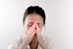 An Asian woman has a pain in nose or sinusitis (sinus infection), pain concept.