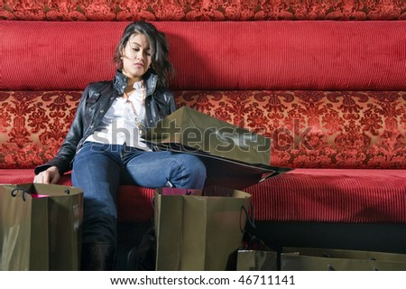 An Asian woman, tired after a shopping frenzy