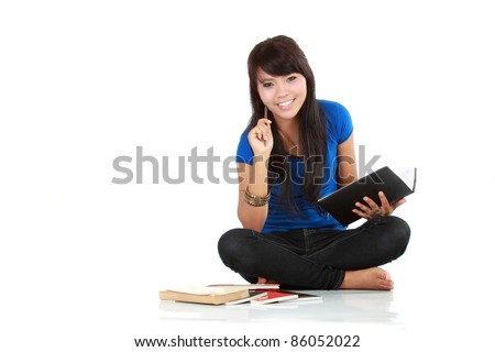 an asian woman writing abook isolated