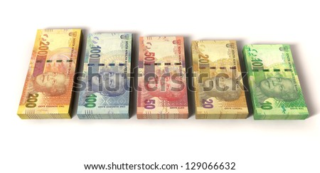 An assortment of all new south african notes in stacks depicting nelson mandela on an isolated background