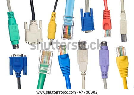 An assortment of computer cables in a variety of colors. - stock photo