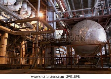 an assortment of different size and shaped pipes at a power plant. - stock photo