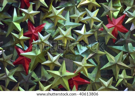 an assortment of festive decorations in metallic green red and white