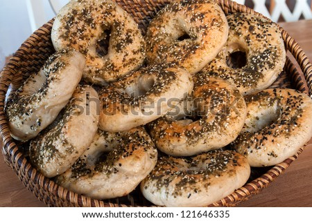 An assortment of fresh healthy bagels with spices and herbs