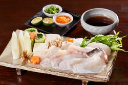 An assortment of ingredients for fugu nabe (blowfish hot pot),  Tecchiri nabe set