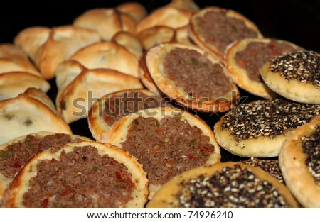 stock-photo-an-assortment-of-lebanese-baked-food-spinach-pies-man-oushe-with-zaatar-and-minced-meat-small-74926240.jpg