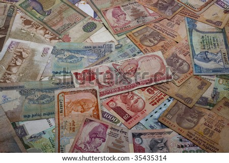 an assortment of paper money from around the world