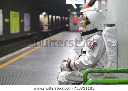 An astronaut just landed from space, on the new planet, explore the new world and live there. Concept of: success road, dreams, astronaut, inspiration.