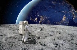 An astronaut standing on the surface of the moon looking up to the earth on the background. Elements of this image furnished by NASA.
