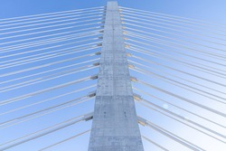 An asymmetric cable-stayed bridge with a 168-metre-high (551 ft) concrete tower and stay cables in a harp arrangement forming the Samuel De Champlain Bridge. It is one of the widest bridges.