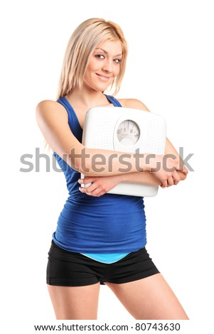 An athlete female holding a weight scale isolated on white background
