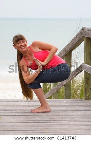 An Athletic Brown Haired Woman Is Doing Yoga Exercise