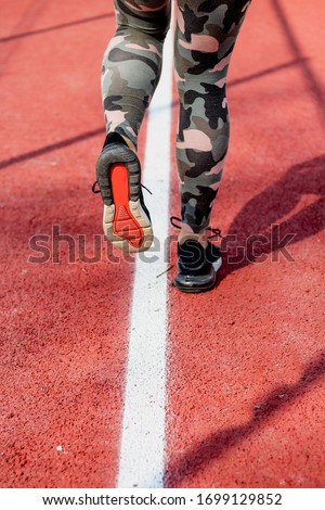 an athletic pair of legs going for a jog . Stock fotó ©