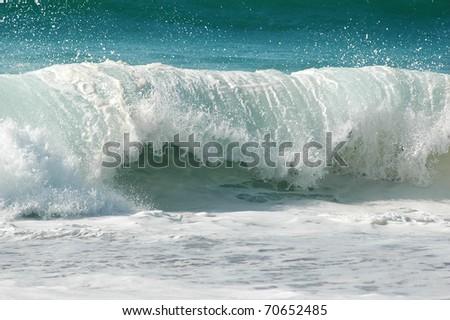 an atlantic wave breaks powerfully onto the shore