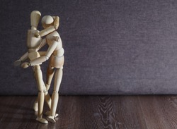 An attacker attacks a passerby. Wooden figures. The concept of violence.