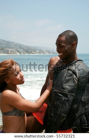 an attractive african american couple enjoy a day at the beach