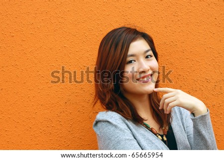 An attractive and beautiful Chinese girl smiling - stock photo