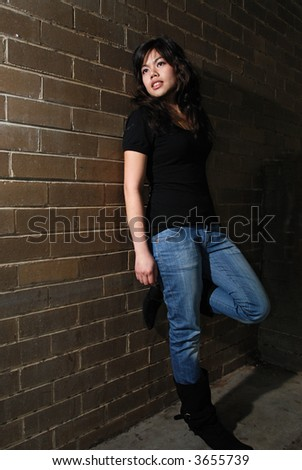 An attractive asian girl in a dark alley #3655739