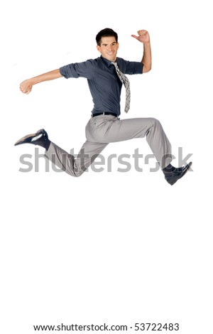 An attractive athletic businessman jumping up against white background
