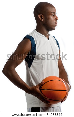 An attractive athletic man holding a basketball against white background