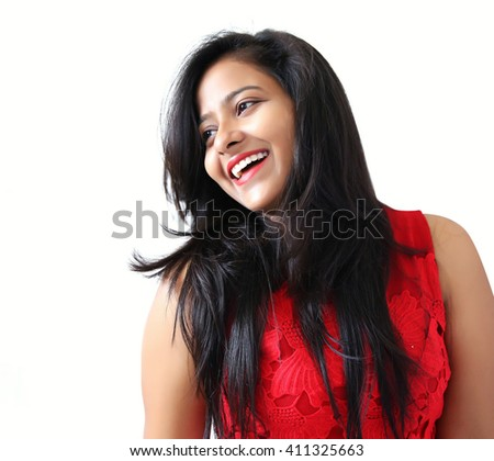 An Attractive beautiful happy young Indian woman smiling on white background