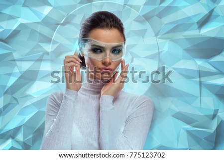 An attractive brunette model in futuristic office with virtual holographic glasses #775123702