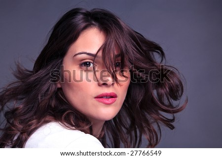 An attractive brunette woman flicking her hair