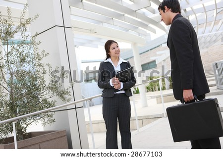 An attractive business man and woman team at the office