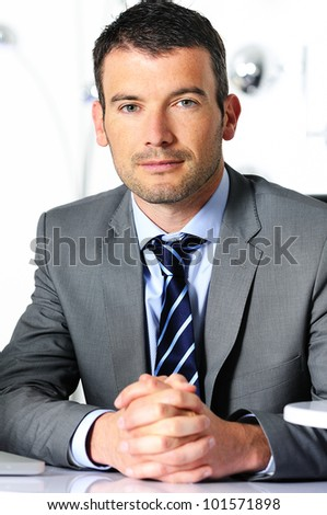 An attractive business man in a light business environment