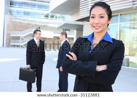 An attractive business team at the office with woman in front