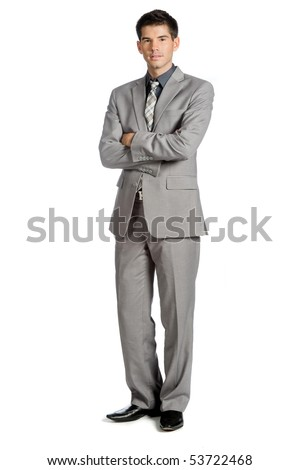 An attractive businessman standing against white background