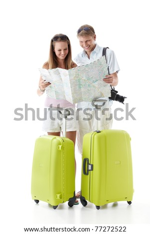 An attractive couple with suitcases see map on a white background
