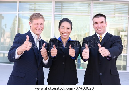 An attractive, diverse business team at the office celebrating success