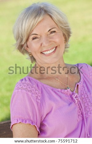 An attractive elegant smiling senior woman