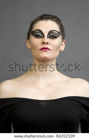 An attractive girl in beautiful makeup in Black Swan Movie style.