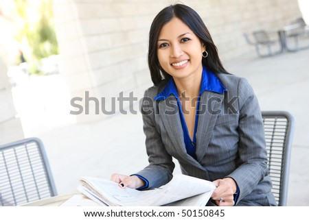 An attractive Indian business woman outside office building