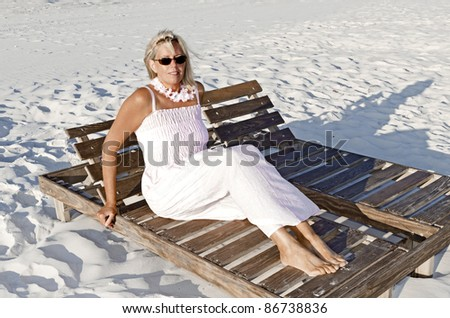 An attractive middle age lady at the beach on the Alabama Gulf Coast.