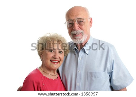 An attractive senior couple against a white background. Horizontal view.