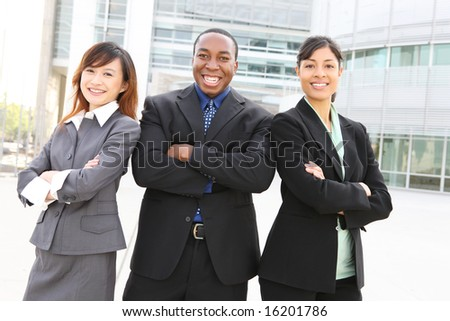 An attractive team of diverse business people at company office building