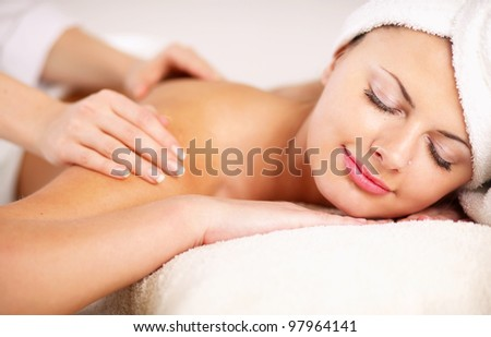 An attractive woman getting spa treatment, isolated on white