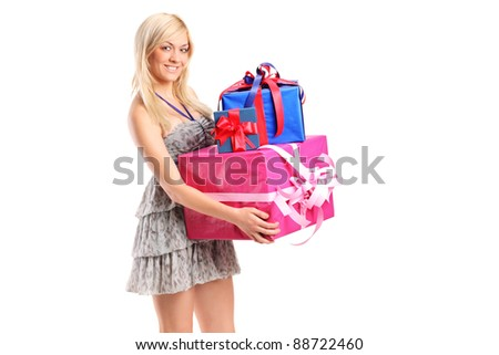 An attractive woman holding a gifts isolated on white background
