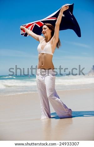 An attractive woman holding an Aussie beach towel