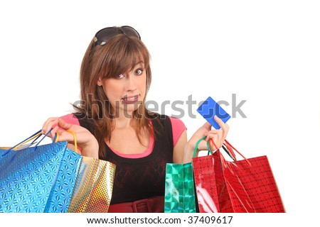 An attractive woman with colorful shopping bags who bought too much.