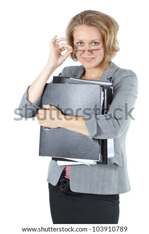 An attractive young blond businesswoman with glasses, standing with folder, smiling into the camera - isolated on white