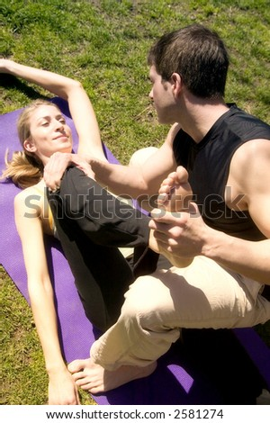 An attractive young couple work out in Central Park, New York.