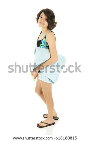 An attractive young teen looking at the viewer as she's off to the beach in her bathing suit, a towel and flip-flops.  She holds a snorkel in her hands.  On a white background.
