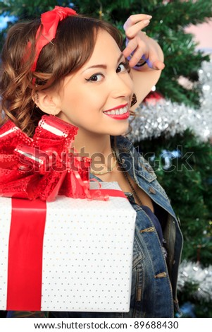 An attractive young woman is celebrating Christmas.