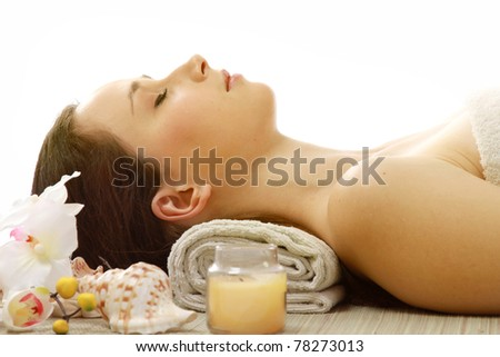 An attractive young woman receiving spa treatment
