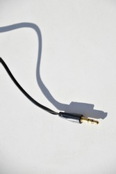 an audio jack and cable on a white surface