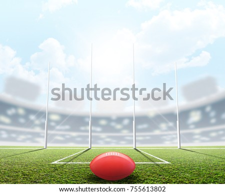 An aussie rules football stadium with a ball and goal posts in the daytime under a blue sky - 3D render